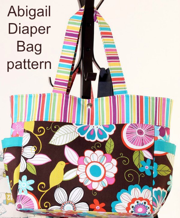 This is a great looking Diaper Bag. It's the Abigail Diaper Bag and like the designer we feel that it really is a cut above the usual mass produced shop-bought ones. It's a vibrant, modern and trendy bag where you can really show off your current favorite fabrics.